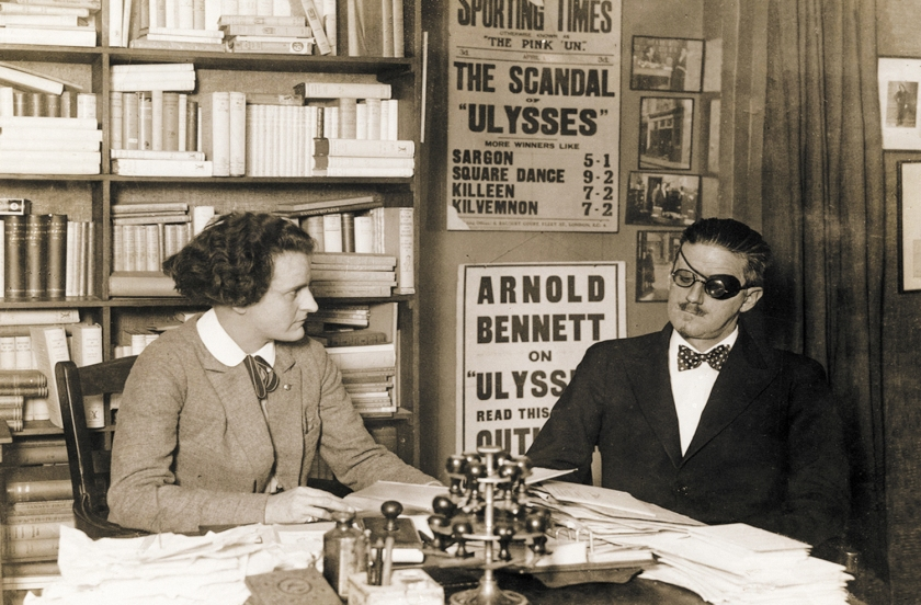 Sylvia-Beach-and-James-Joyce-at-Beach_s-bookshop-Shakespeare-and-Company-in-1922